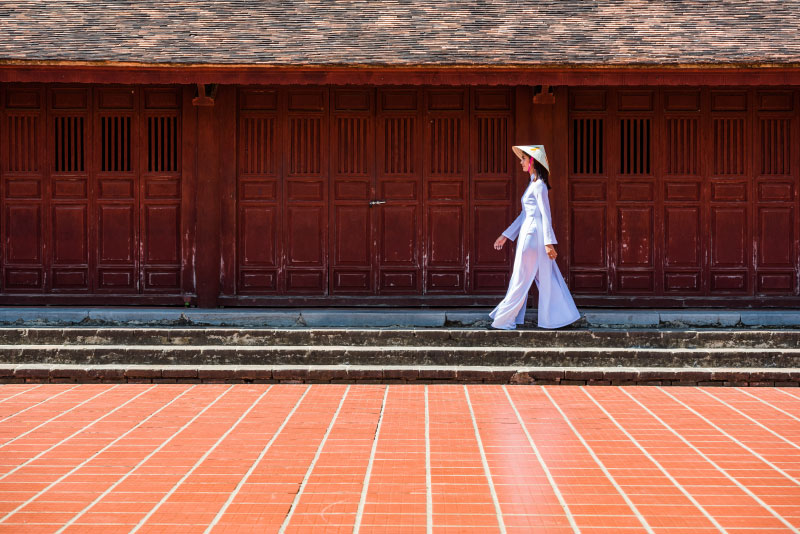 A girl walking in Thien Mu temple, Hue